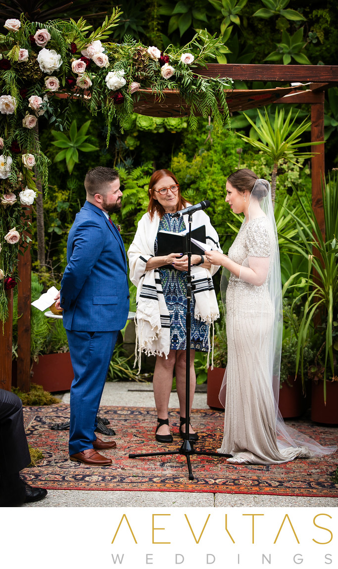 Couple exchange vows at SmogShoppe courtyard wedding