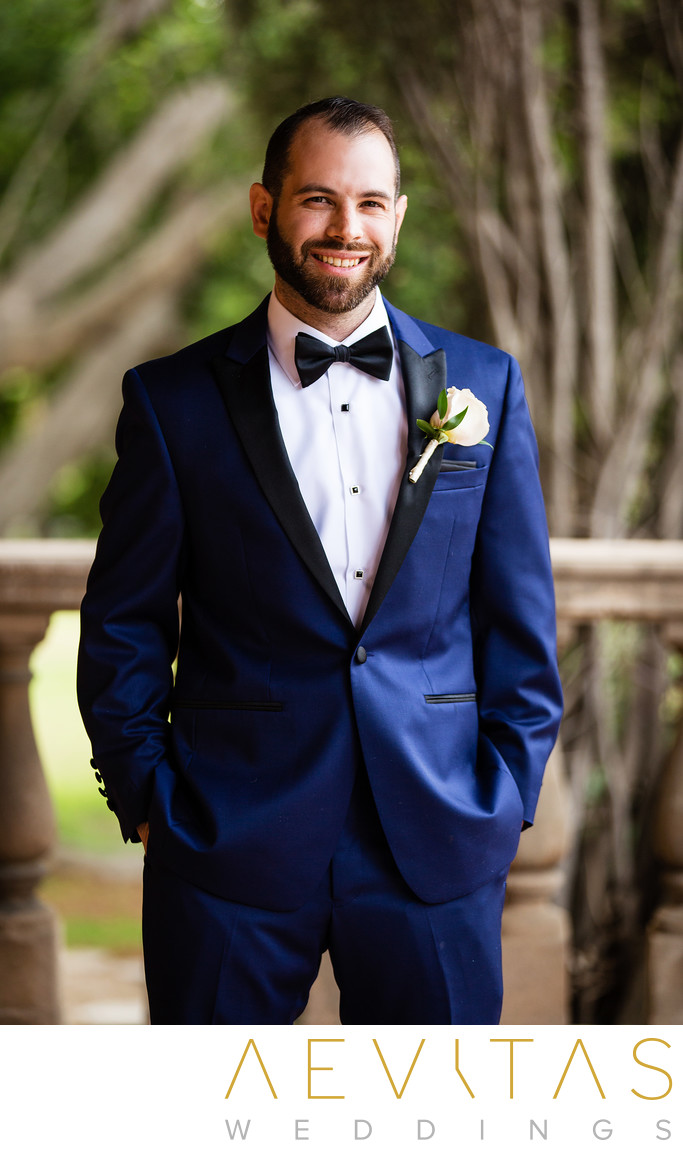 Groom with hands in pockets by LA wedding photographer