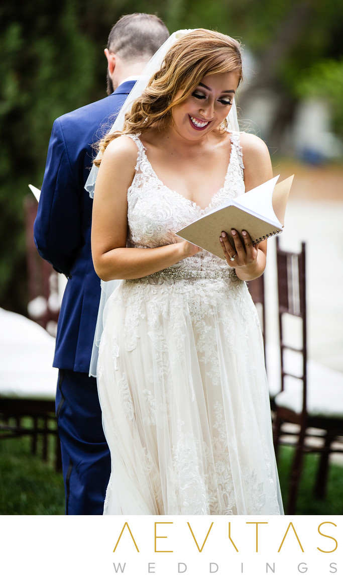 Bride smiles while reading letter from groom