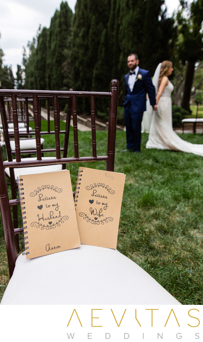 Photo of notebooks with bride and groom holding hands