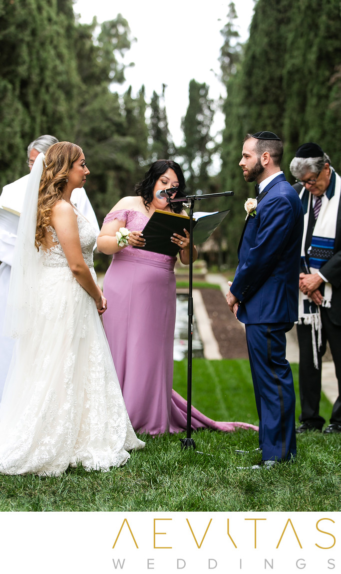 Bride and groom during wedding ceremony reading