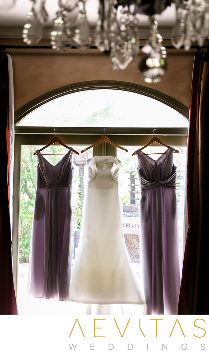 Bride and bridesmaid dress in naturally-lit window