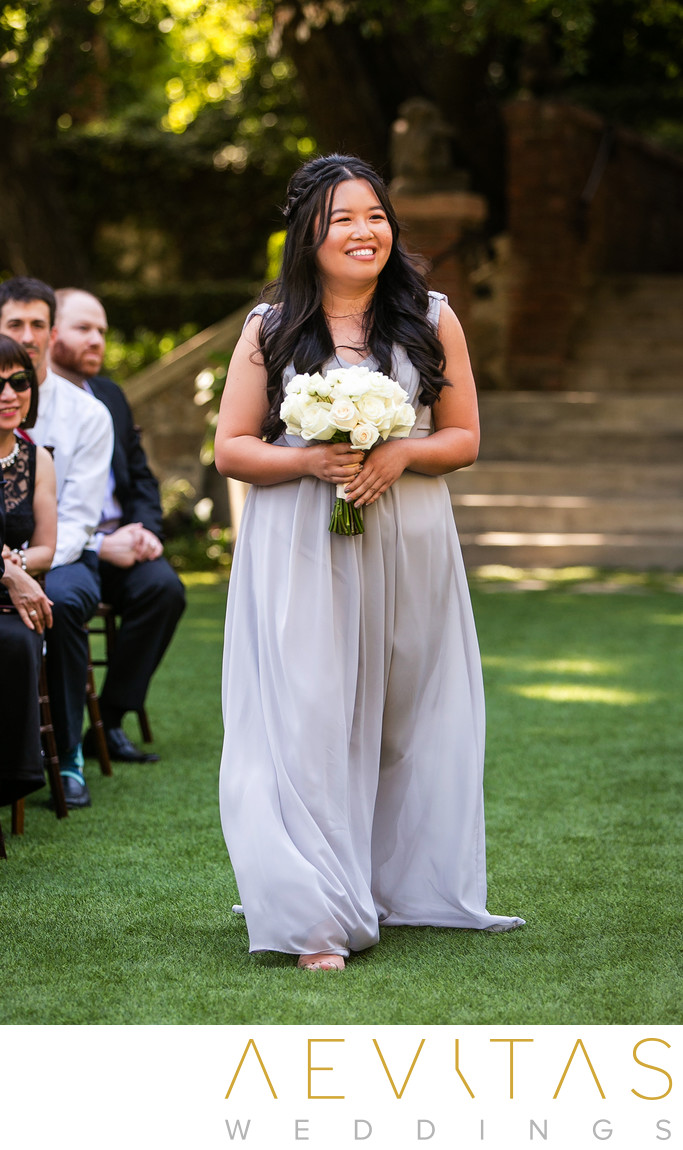 Bridesmaid walking down aisle at The Houdini Estate