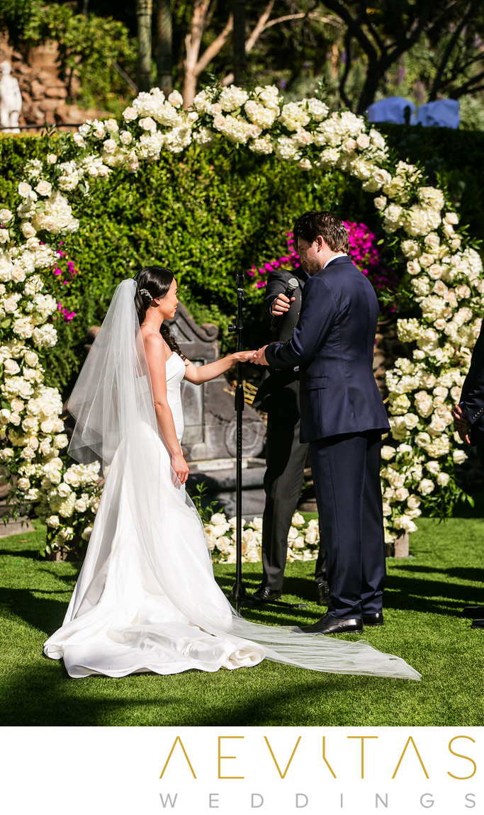 Couple exchange rings at The Houdini Estate wedding