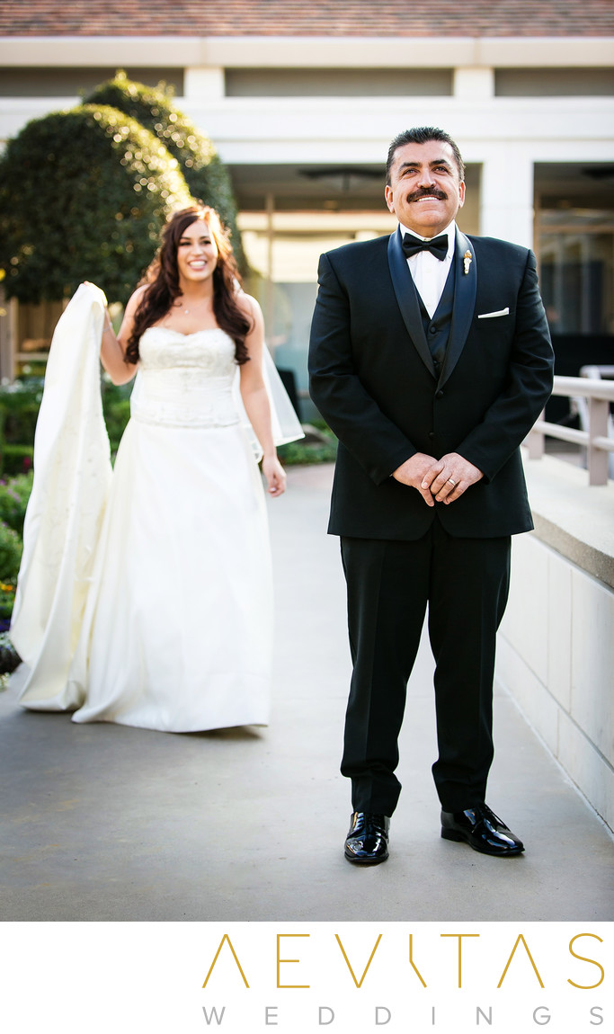 Bride walking to father during Yorba Linda first look