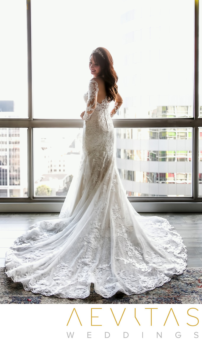Bride portrait beside window with Downtown Los Angeles