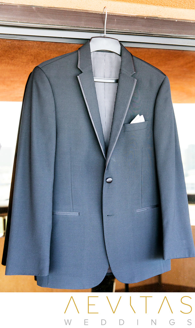 Groom's gray suit jacket at Hotel Irvine wedding
