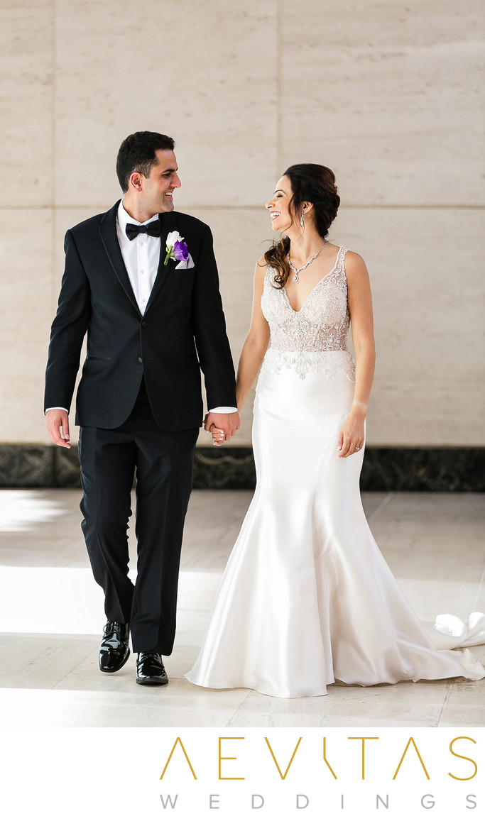 Couple smiling and walking at Hotel Irvine wedding