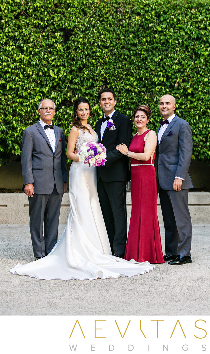 Couple with groom's family at Hotel Irvine wedding