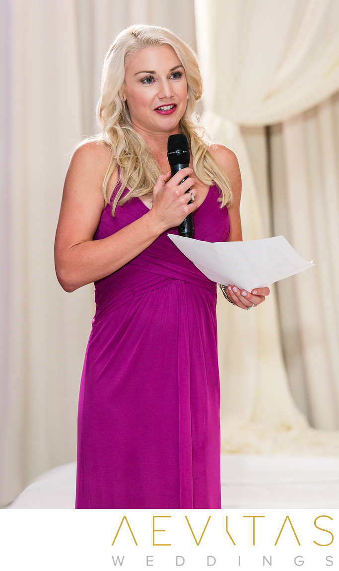 Bridesmaid wearing pink Hotel Irvine reception speech