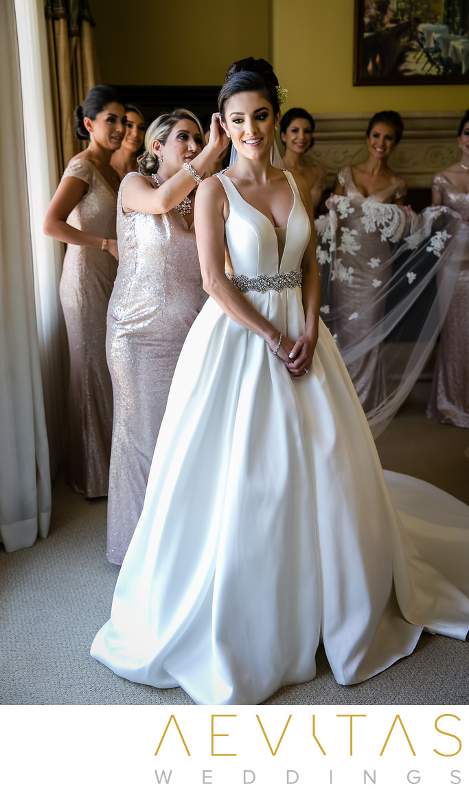 Candid bride and bridesmaids getting ready Arden Hills