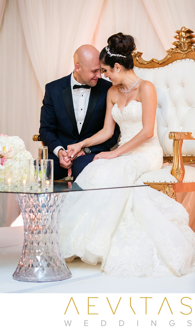 Tender couple moment at Arden Hills sweetheart table