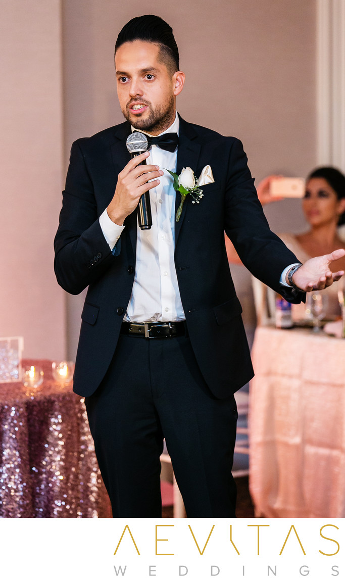 Brother making speech at Persian wedding reception
