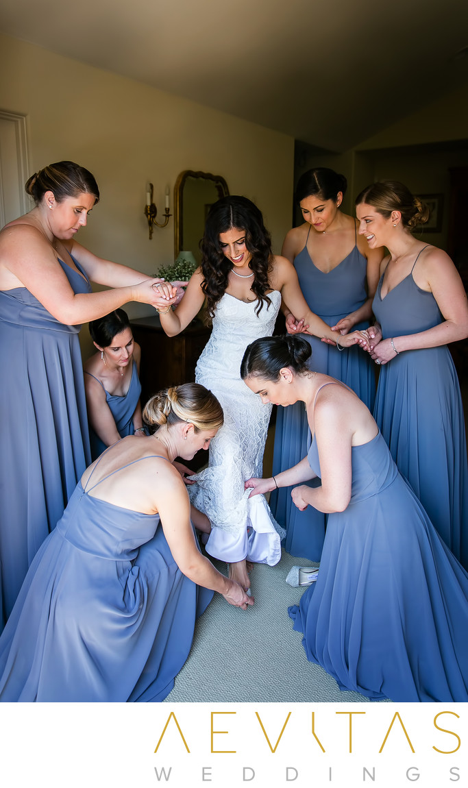 Bride stepping into wedding shoes at LA private home