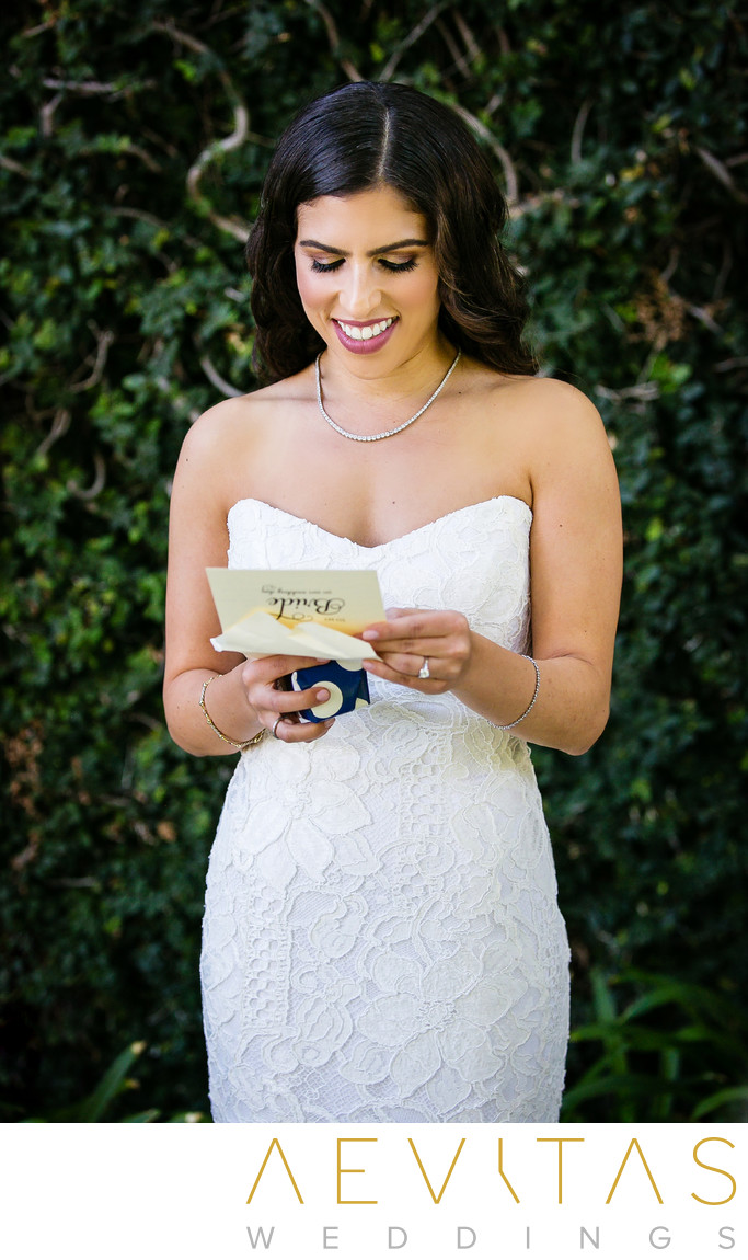Bride reads note from groom at Skirball wedding in LA