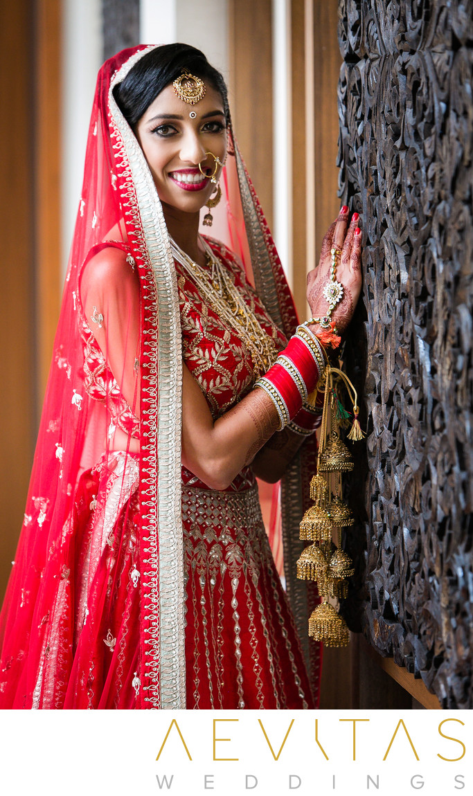 Bride in red sari at Pasea Hotel and Spa wedding