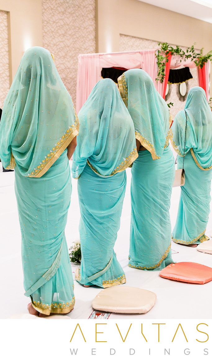 Bridesmaids in turquoise saris at Sikh wedding