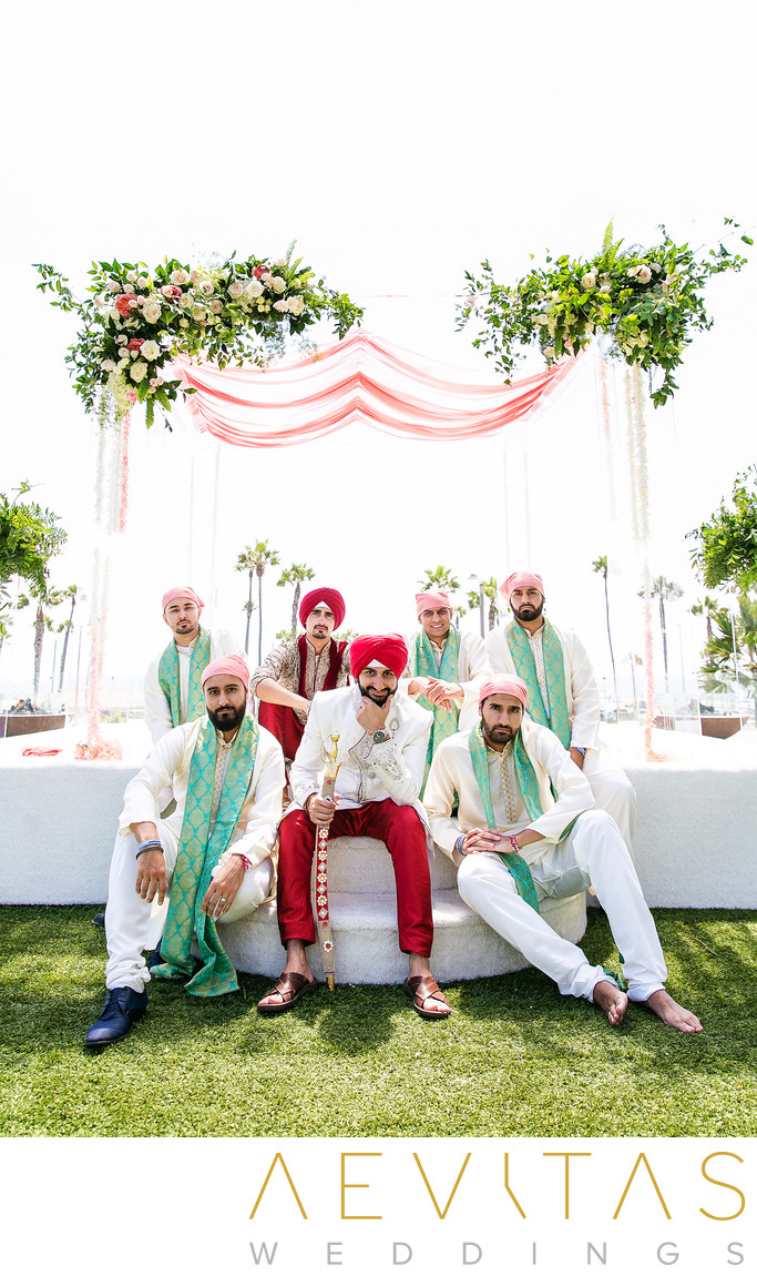 Groom with groomsmen on mandap stage at Indian wedding