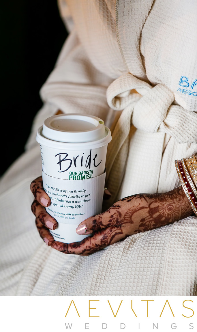 Bride holding coffee with henna hands in San Diego