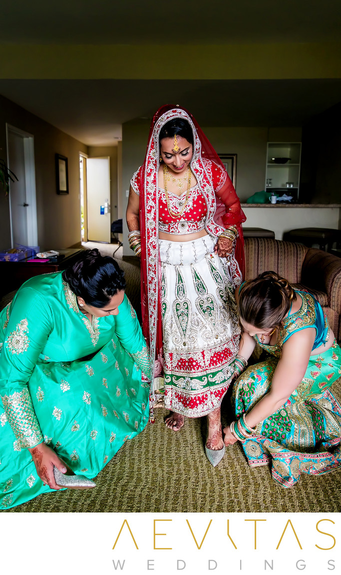 Indian bride putting on shoes for San Diego wedding