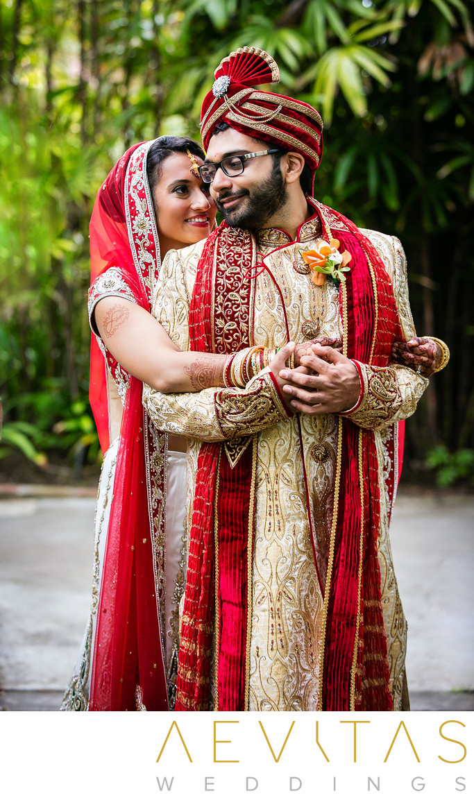 Indian bride embraces groom in San Diego