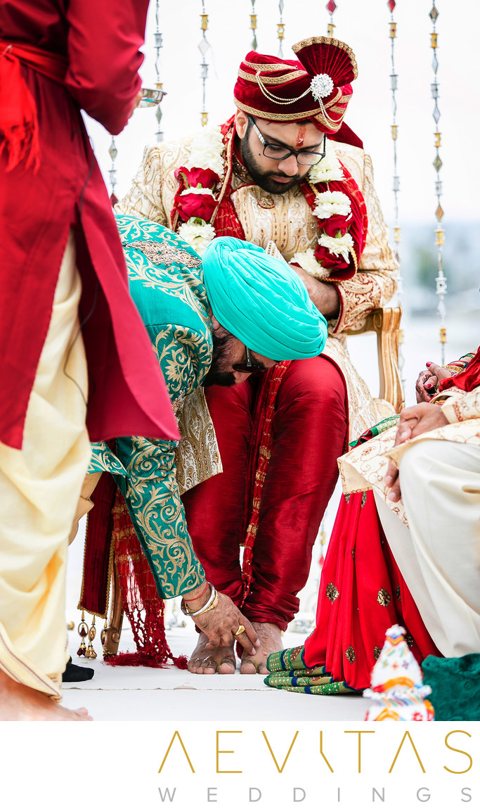 Father-of-bride touches Indian groom's feet