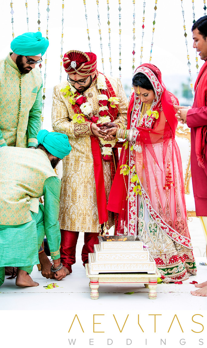 Brother touches groom's feet at Indian wedding ceremony