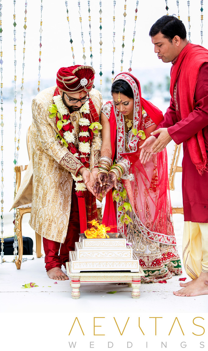 Couple pour water on fire at Indian wedding ceremony