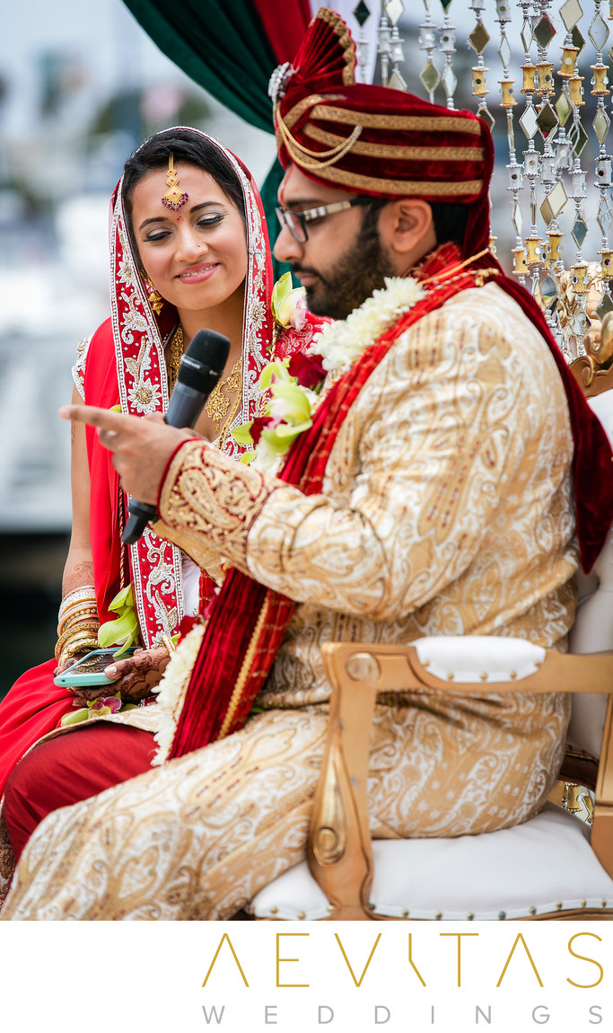 Groom reads vows to bride at Indian wedding