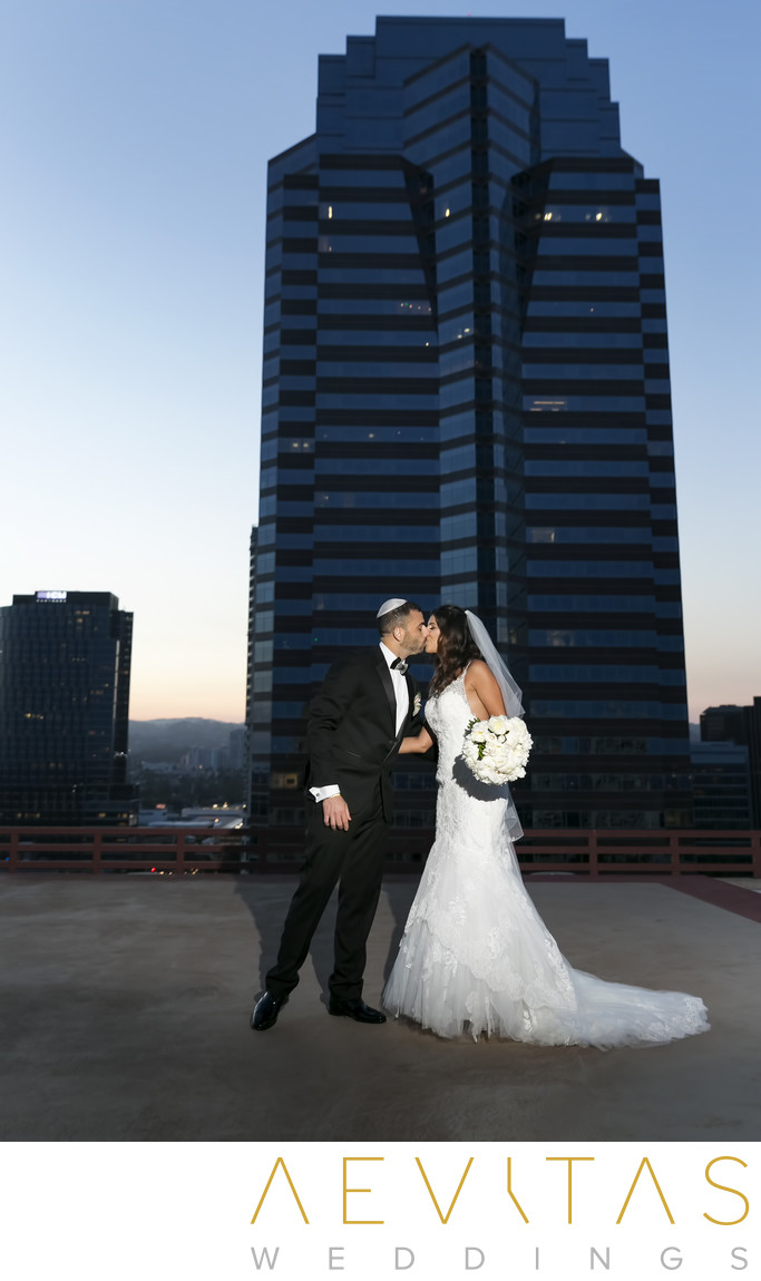 Couple kiss with skyscraper in Century City