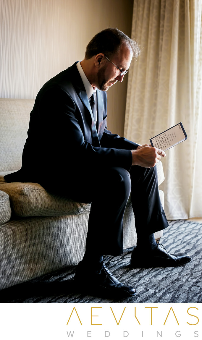 Groom reading note at Fess Parker DoubleTree Resort