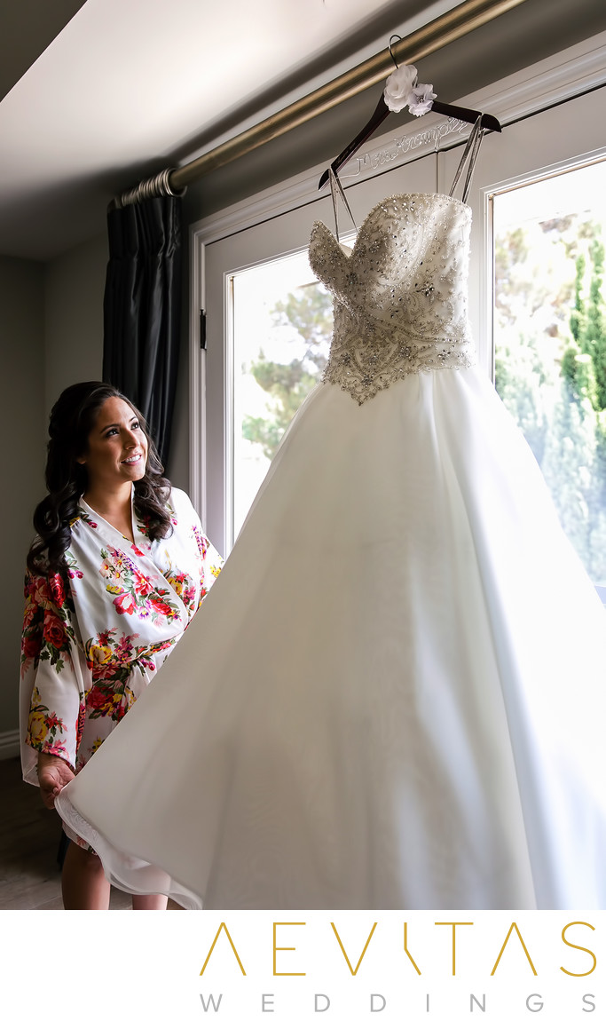 Bride admiring dress at private Los Angeles residence