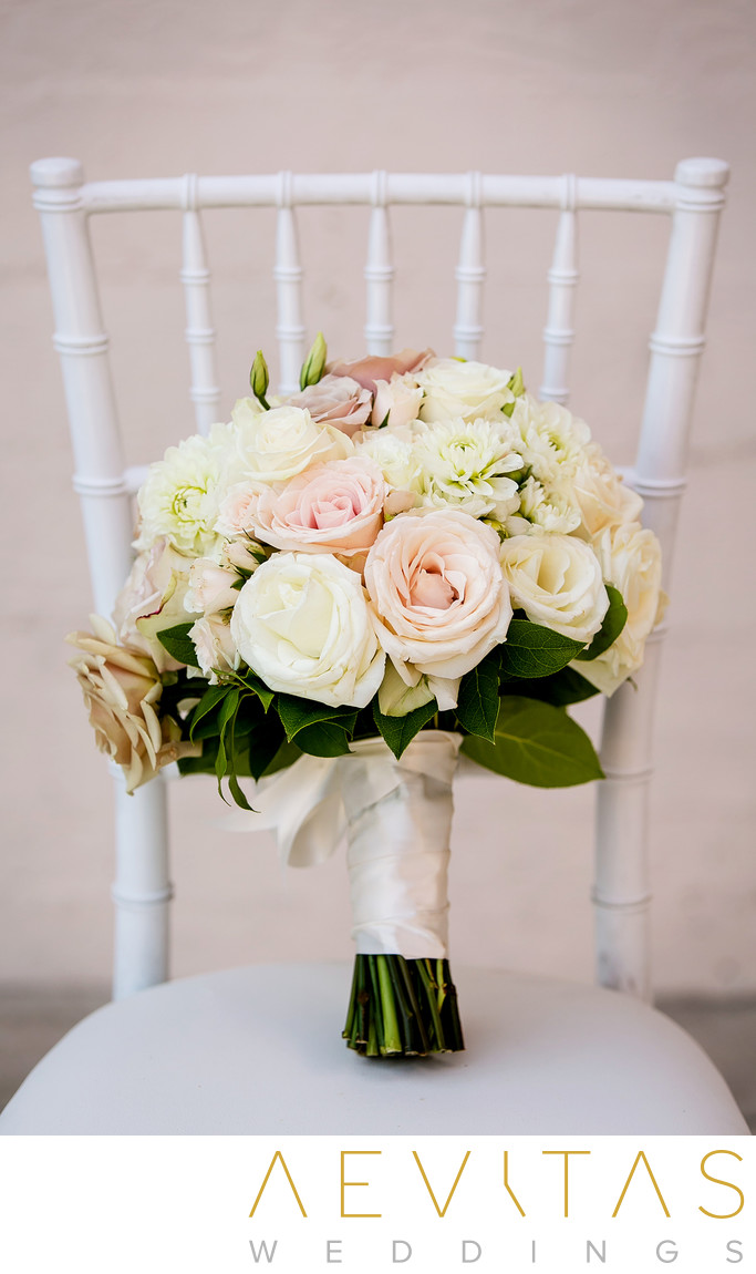 Bride's bouquet on white chair at Ebell Los Angeles