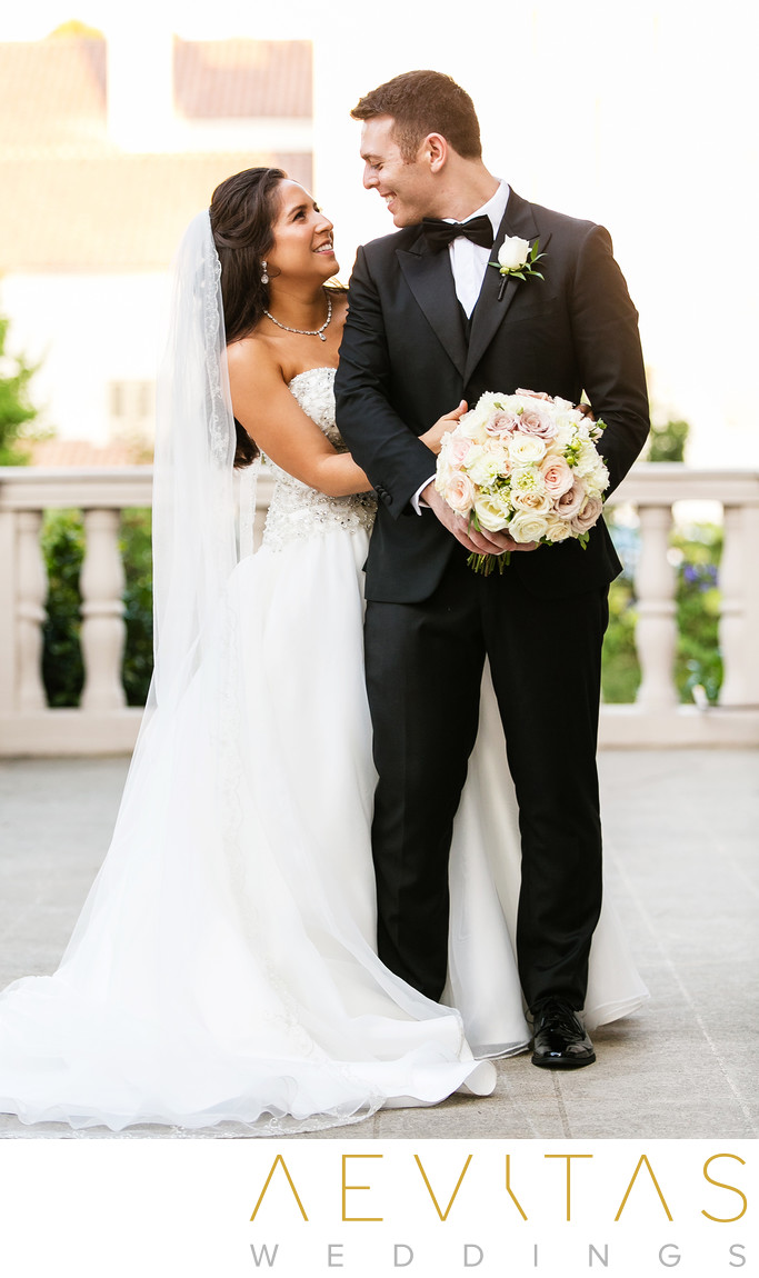 Bride hugs groom on The Ebell of Los Angeles terrace