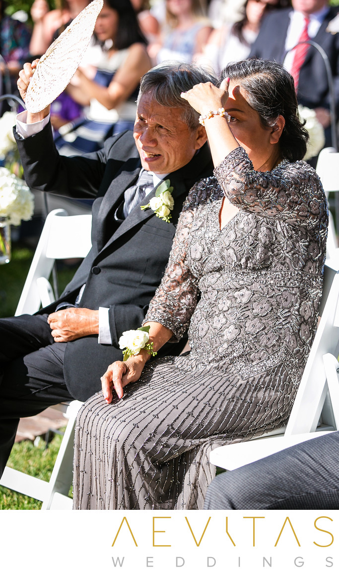 Bride's parents watching wedding ceremony in Oak Glen