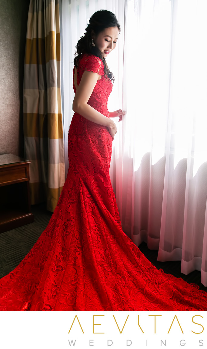 Bride wearing elegant red Chinese qi pao dress