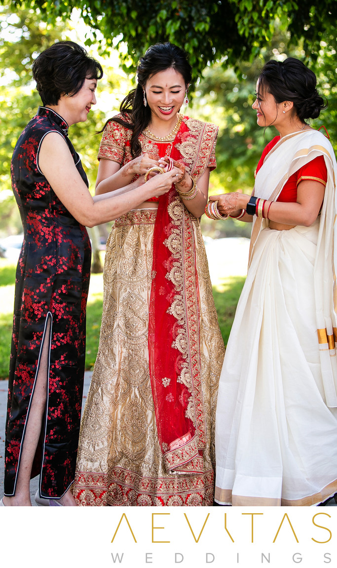Bride putting on bangles at Indian wedding in Pomona