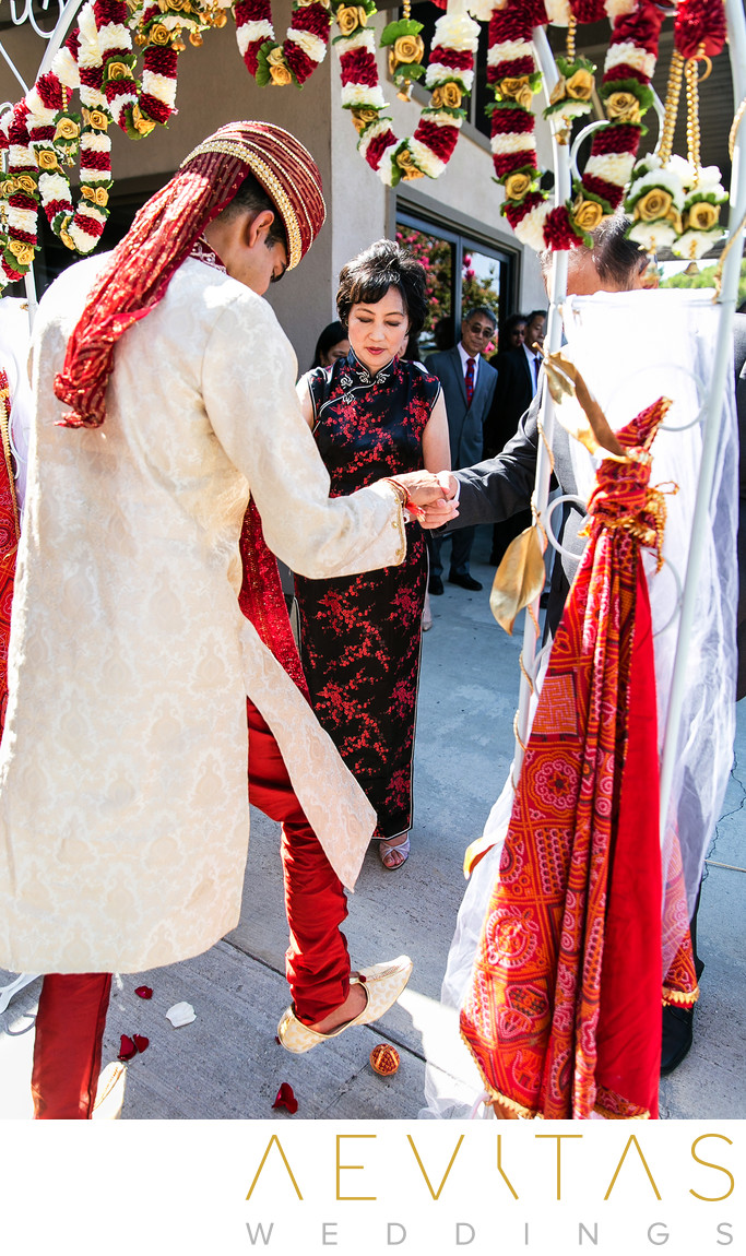 Groom performs Hindu ritual with mother-of-the-bride