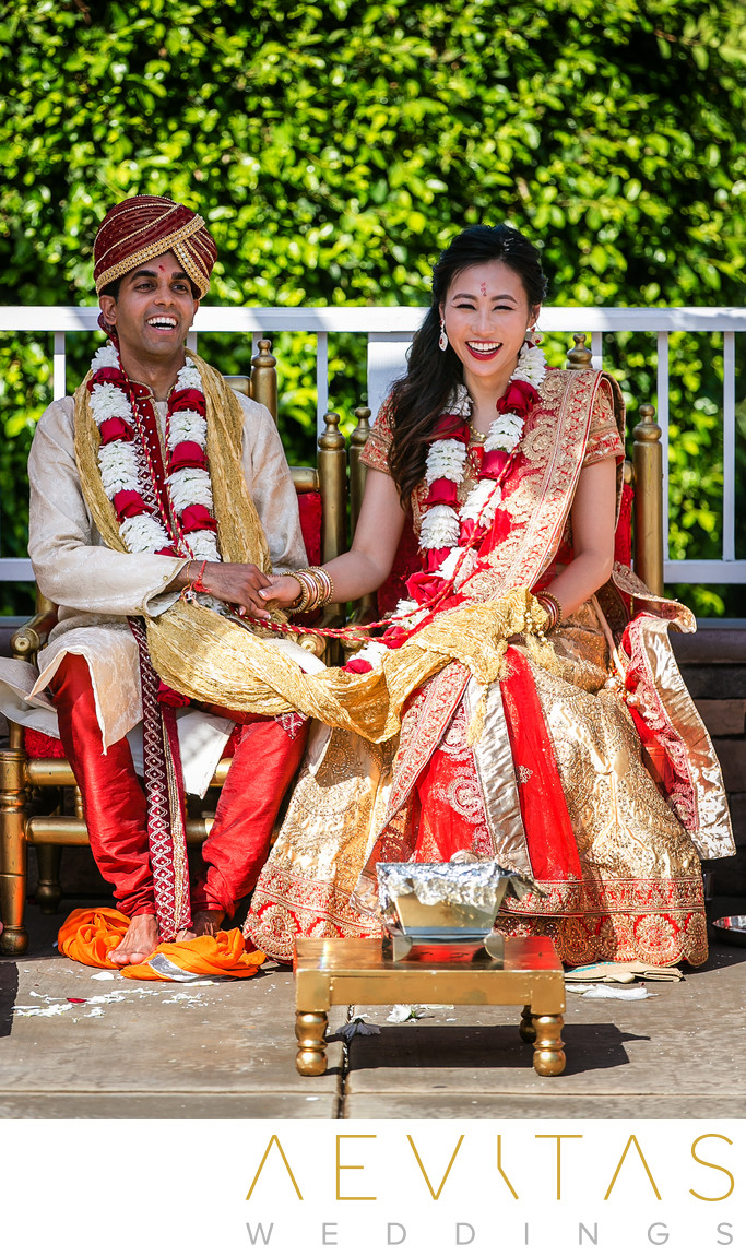 Couple laughing at Mountain Meadows Hindu wedding
