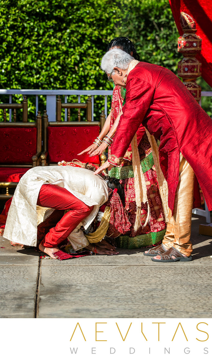 Groom bows at parents' feet during Pomona Hindu wedding