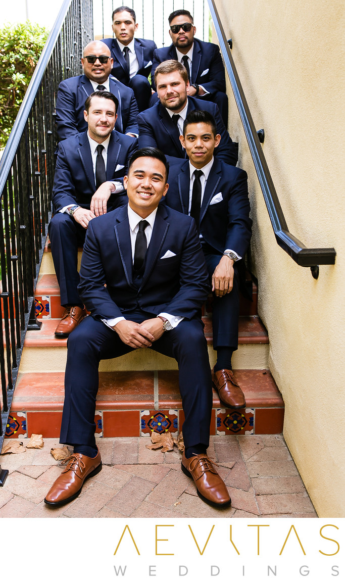 Groomsmen sitting on stairs at Terranea Resort