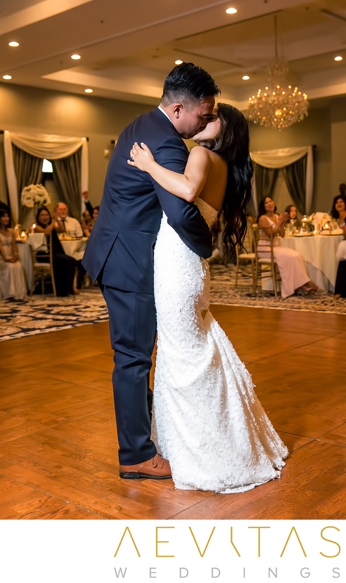 Couple kiss first dance at Trump National Golf Club
