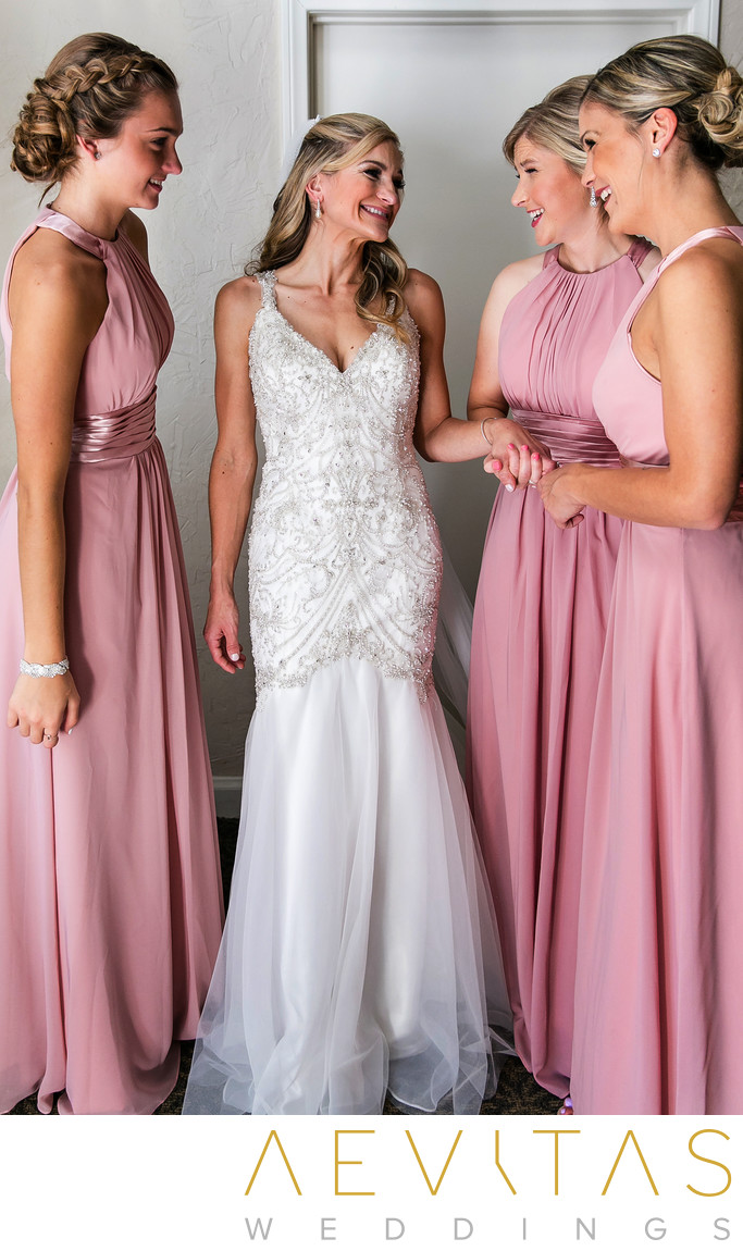 Bride with three bridesmaids wearing pink dresses