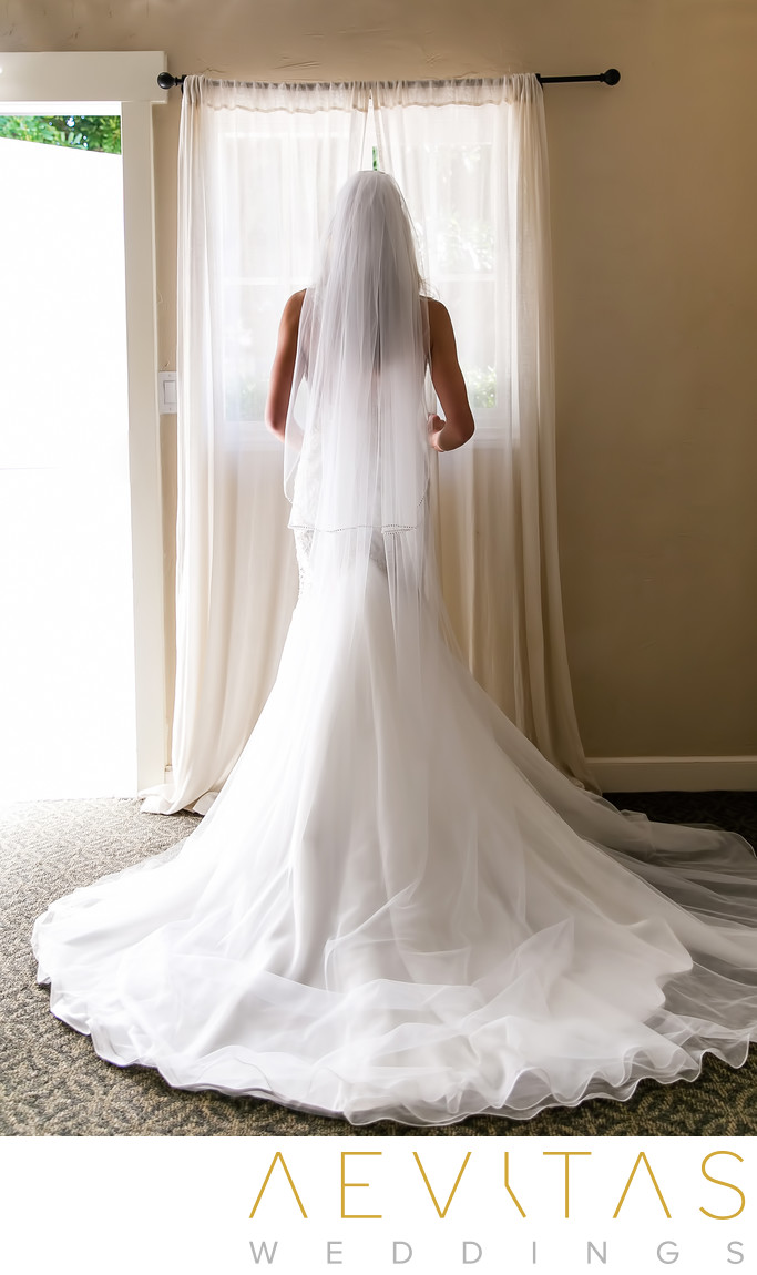 Beautiful bride portrait at suite window San Clemente
