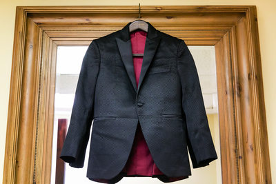 Groom's suit jacket hanging in a Mission Inn doorway