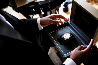 Groom opens a watch gifted on his wedding day