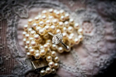 Ring and pearls by Santa Barbara wedding photographer