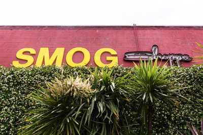SmogShoppe sign on red-brick building in Los Angeles