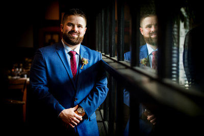 Reflective groom portrait by LA wedding photographer