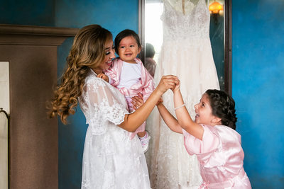 Bride and flower girls with wedding dress Sierra Madre